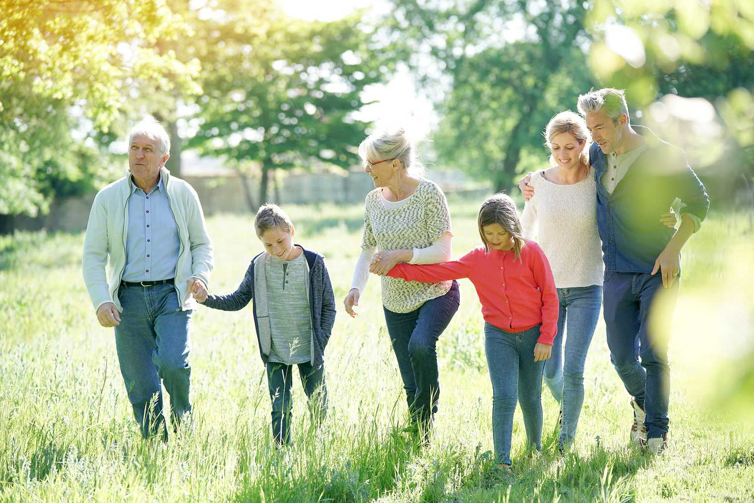 An extended family enjoying the landscaped gardens of a retirement village.